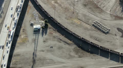 Overhead View of Freight Train Passing Through Industrial Area Stock Footage