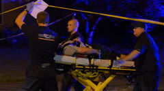 Medics Transporting Victim From A Crime Scene After A Stabbing - stock footage