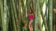 Stock Video Footage of Girl at the Bamboo thickets
