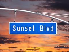 Sunset blvd overhead street sign with dusk sky Stock Photos