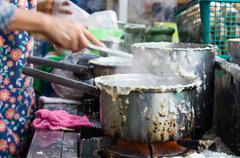 The preparation of rice porridge Stock Photos