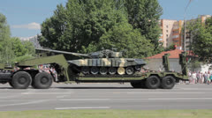 Military truck carries tank on the street Stock Footage