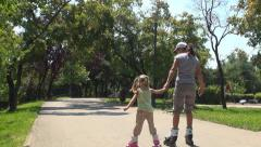 Mother and Child Walking with Roller Skates on Path in Park, Family Making Sport - stock footage