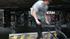 Man jumps over obstacle on bicycle at the southbank, london, england Stock Footage