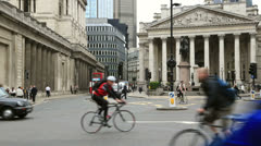 London buses, taxis and cyclists pass in front of the bank of England Stock Footage