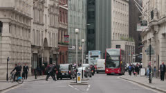 Red bus and office workers in fenchurch street in the city of london, england Stock Footage