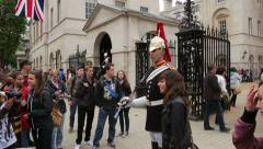 Tourists have picture taken with horse guard at horse guards parade Stock Footage