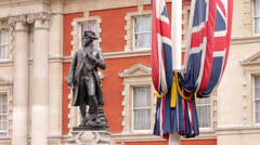 Statue of captain james cook with flags at admiralty arch, london, england Stock Footage