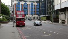 Traditional london red routemaster bus stops at bus stop in london, england Stock Footage