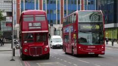 Traditional red buses in london, england Stock Footage