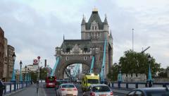 Emergency ambulance passes across tower bridge, london Stock Footage