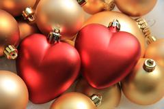 red heart shaped christmas ornaments - stock photo