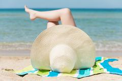 Woman sunbathing Stock Photos