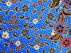 Värikäs batiikki kangas tausta Kuvituskuvat