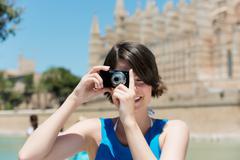 tourist taking pictures in palma de mallorca - stock photo