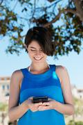 Woman texting on her mobile phone Stock Photos