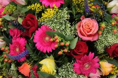 Mixed flower arrangement in bright colors Stock Photos