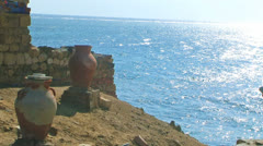 Amphora on beach near sea. Stock Footage