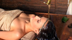Woman having Ayurvedic spa treatment. Stock Footage
