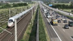 Traffic jam on german highway, approcaching ICE train Stock Footage