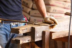 worker bending stee - stock photo