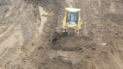 Yellow Bulldozer Raking Clay Stock Footage