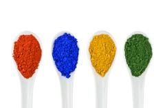 vibrant color pigments in porcelain spoons - stock photo