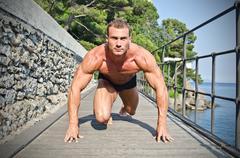 Young bodybuilder ready to sprint and run Stock Photos