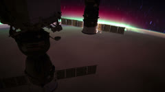 International Space Station orbiting over Pacific ocean. Aurora can be seen. Stock Footage