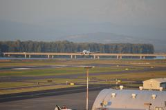 Jet Landing at Portland Airport - stock photo