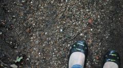 Woman in Ballerina is walking on a dirty earthway in the Forest Stock Footage