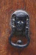 Metal knocker, pharaoh-shaped Stock Photos