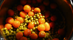 Cooking peas and carrots Stock Footage