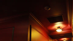 Dark, red hotel ceiling Stock Footage