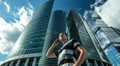 Man stands near Moscow sky-scrapers, RAW VIDEO:6K & 4K & 1080p resolutions Footage