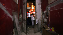 A doorway frames protestors in Cairo, Egypt. Stock Footage