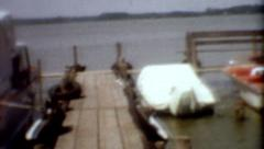 1950s old film boats docked on lake outdoors summer vintage vacation lifestyle Stock Footage
