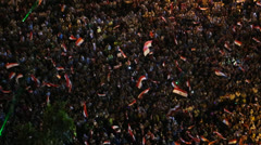 Crowds protest at a nighttime rally in Tahrir Square in Cairo, Egypt. - stock footage