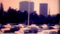 Old film Parking lot Louisiana State Capitol skyline vintage historic cars Stock Footage