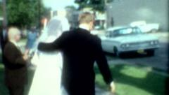 1970s film bride and groom wedding party leaving vintage fashion marriage Stock Footage