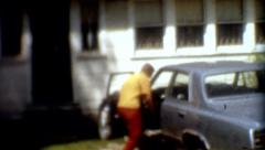 1960s 8mm Film Woman gets newspaper from her Car vintage fashion Stock Footage