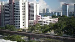 Singapore MRT with HDB in the background Stock Footage