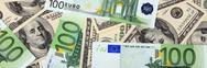 Dollar and euro banknote Stock Photos