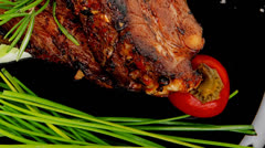served entree: ribs on plate with hot peppers - stock footage