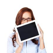 Woman holding up a blank tablet computer Stock Photos