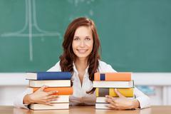 smiling student with her textbooks - stock photo