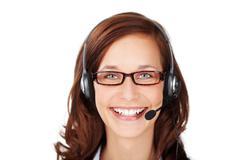 Smiling friendly call centre operator Stock Photos