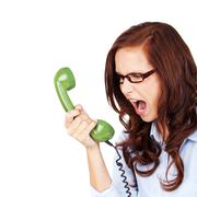 Young woman yelling at a telephone Stock Photos