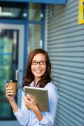 Woman enjoying a coffee break outdoors Stock Photos