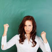 Angry woman shaking her fists Stock Photos